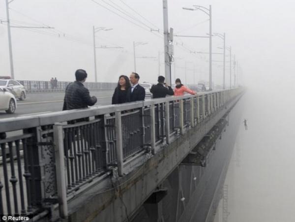 Pareja china se suicida - Fotos